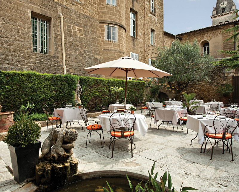 Amura,Agde,AmuraWorld,Amura Yachts,Chateau de Rochegude, The terrace is surrounded by olive trees.
